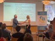 Tove Johansen recieves the membership ceritificate of behalf of ABF Norden.