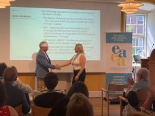 Tove Johansen recieves the membership ceritificate of behalf of ABF Norden.